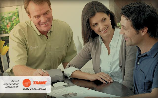 Trane technician consulting with customers