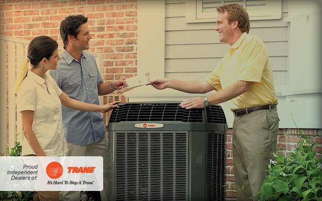 Trane technician introducing a Heat Pump to customers